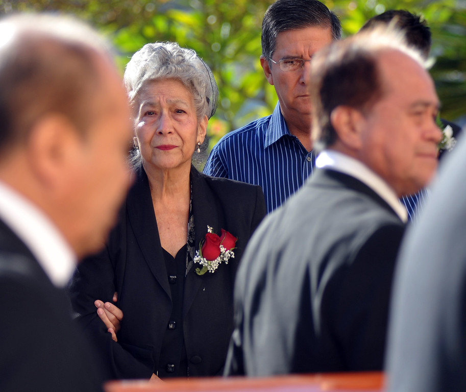 . Celia Jimenez watches as pall bearers bring in the casket during the funeral service for her husband, Mario Jimenez, owner of Mario\'s Taco\'s, at St. Hillary\'s Catholic Church in Pico Rivera on Tuesday October 15, 2013. Jimenez who had been an active member of the community and hosted their free Thanksgiving dinners, died Wednesday October 8th after a long battle with cancer. (Whittier Daily News/Staff Photo by Keith Durflinger)