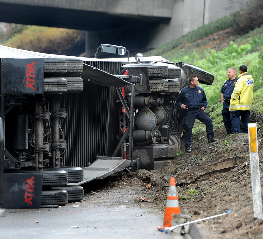 . Three big-rig and two cars crashed, killing a truck driver near the runner on (210) Freeway East.  The accident at 12:01 caused the tunnel to be closed and a SigAlert was called where the tunnel was schedule to reopen by 4 to  5 p.m. Thursday, November 21, 2013. (Photo by Walt Mancini/Pasadena Star-News)
