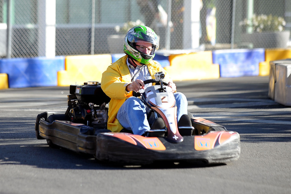 . Daily News reporter Dana Bartholomew takes a lap during a practice run for the Annual Streets of Lancaster Grand Prix in Lancaster, CA September 27, 2013.  The three-day event features professional go-kart racers from across the nation and is free ot the public. (Andy Holzman/Los Angeles Daily News)