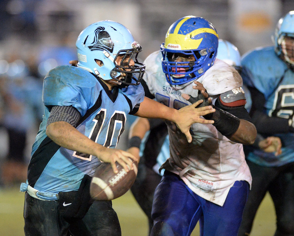 . Arroyo quarterback Nathan Coto (#10) is pressured as they play San Dimas in their CIF Semi-Final football game at Arroyo High School in El Monte on Friday November 22, 2013. (San gabriel Valley Tribune/Staff Photo by Keith Durflinger)