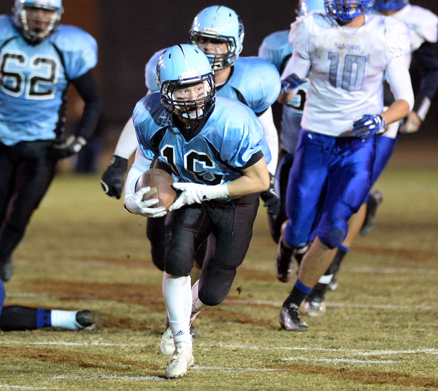 . Arroyo wide receiver Nico Lozano (#16) runs after catching a pass as they play San Dimas in their CIF Semi-Final football game at Arroyo High School in El Monte on Friday November 29, 2013. (San gabriel Valley Tribune/Staff Photo by Keith Durflinger)