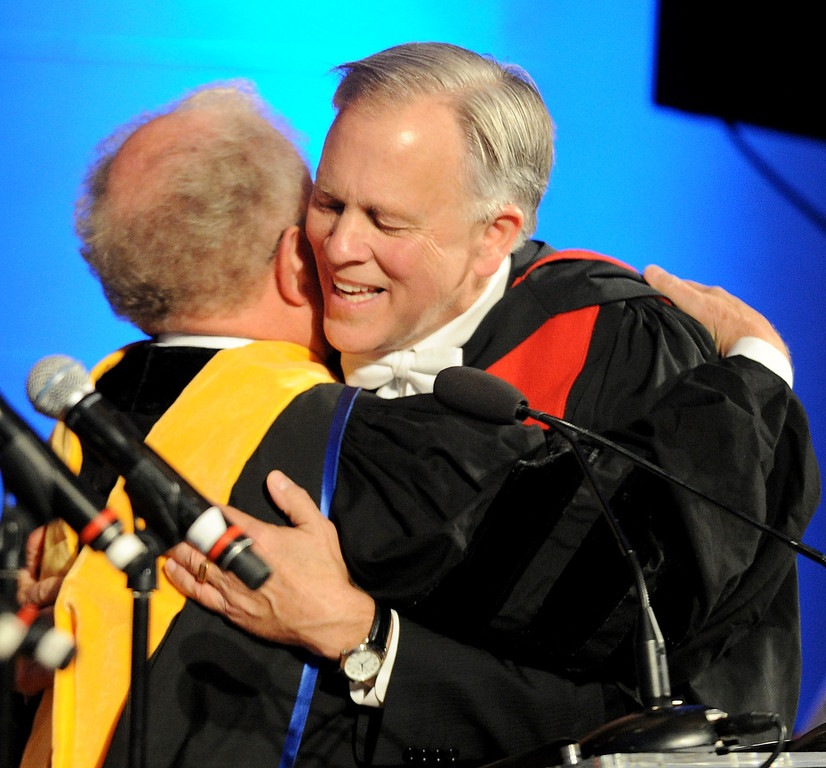 . Clifford Penner, left, Chairman of Board of Trustees, Declaration of Purpose and Inaugural Vows congratulates Mark Labberton, President. Fuller Theological Seminary celebrated the inauguration of its Fifth President, Mark Labberton, on Wednesday at First United Methodist Church in Pasadena Wednesday, November 6, 2013.(Photo by Walt Mancini/Pasadena Star-News)