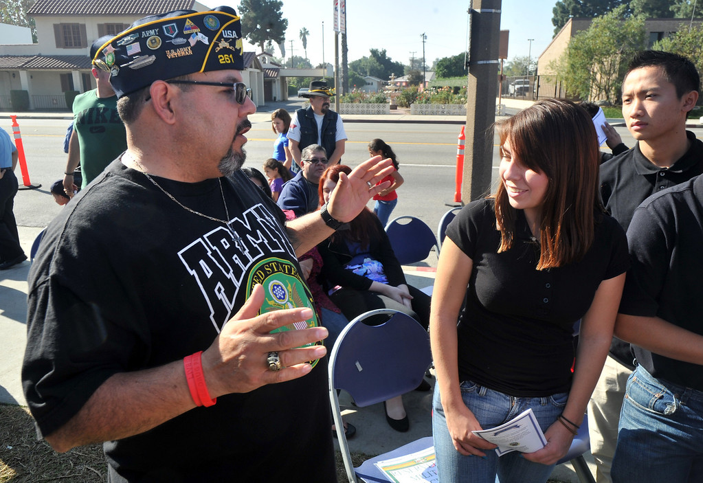 . Veteran Leonard Villalobos Leon congratulates Army recruit Daisy Villegas after being sworn into service during the Veterans Day Celebration at El Monte City Hall on Monday November 11, 2013. Veterans are honored with speeches and music and a flag ceremony. (San Gabriel Valley Tribune/Staff Photo by Keith Durflinger)