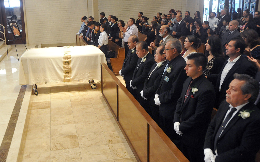 . Family members and the community gather for the funeral service for Mario Jimenez, owner of Mario\'s Taco\'s, at St. Hillary\'s Catholic Church in Pico Rivera on Tuesday October 15, 2013. Jimenez who had been an active member of the community and hosted their free Thanksgiving dinners, died Wednesday October 8th after a long battle with cancer. (Whittier Daily News/Staff Photo by Keith Durflinger)