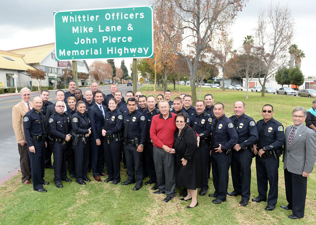 . Assemblymember Ian Calderon joins city and police officials as they unveil the Whittier Officers Memorial Highway on Whittier boulevard at Penn Street on Thursday December 19, 2013. A portion of State Route 72 from the western entrance at the intersection of Penn Street and Whittier Boulevard to the eastern entrance of State Route 72 at the intersection of Costa Glen Avenue and Whittier Boulevard as the Whittier Officers Mike Lane and John Pierce Memorial Highway. (Photo by Keith Durflinger/Whittier Daily News)