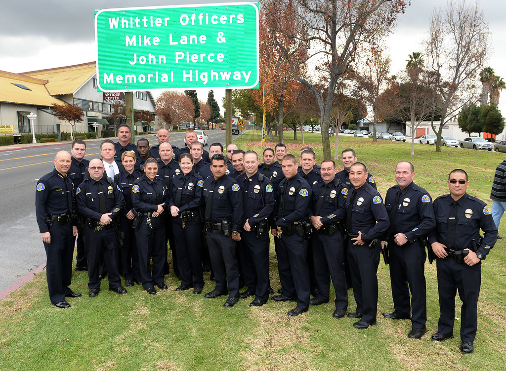 . Whittier Police Officers stand in front the Whittier Officers Memorial Highway on Whittier boulevard at Penn Street on Thursday December 19, 2013. A portion of State Route 72 from the western entrance at the intersection of Penn Street and Whittier Boulevard to the eastern entrance of State Route 72 at the intersection of Costa Glen Avenue and Whittier Boulevard as the Whittier Officers Mike Lane and John Pierce Memorial Highway. (Photo by Keith Durflinger/Whittier Daily News)