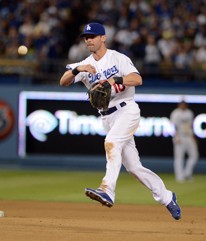 . The Dodgers\' Michael Young throws to 1st during their game against the Rockies at Dodgers Stadium Saturday, September 28, 2013. (Photo by Hans Gutknecht/Los Angeles Daily News)