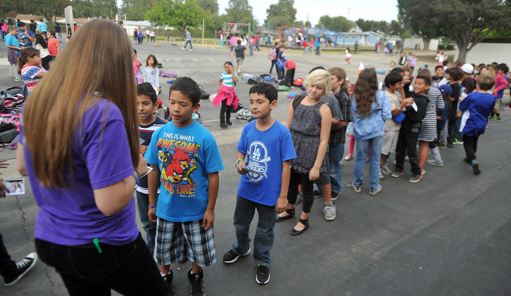 . Country Western singer Lizzie Sider, 15, signs autographs during her 80-school California Bully Prevention Tour for students at Ocean View Elementary School in Whittier on Monday November 4, 2013. (Whittier Daily News/Staff Photo by Keith Durflinger)