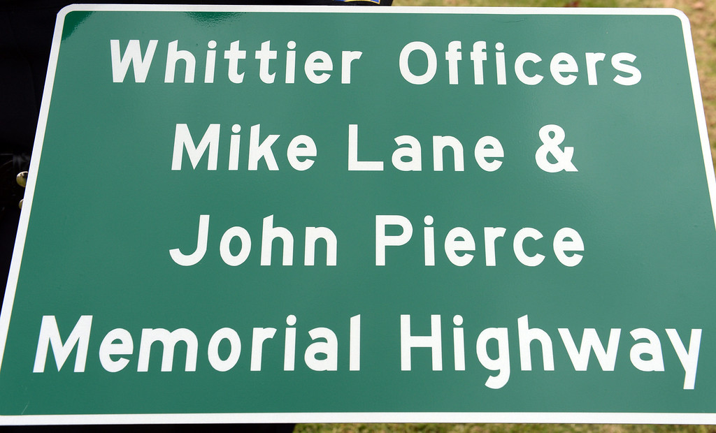 . City officials unveil the Whittier Officers Memorial Highway on Whittier boulevard at Penn Street on Thursday December 19, 2013. A portion of State Route 72 from the western entrance at the intersection of Penn Street and Whittier Boulevard to the eastern entrance of State Route 72 at the intersection of Costa Glen Avenue and Whittier Boulevard as the Whittier Officers Mike Lane and John Pierce Memorial Highway. (Photo by Keith Durflinger/Whittier Daily News)
