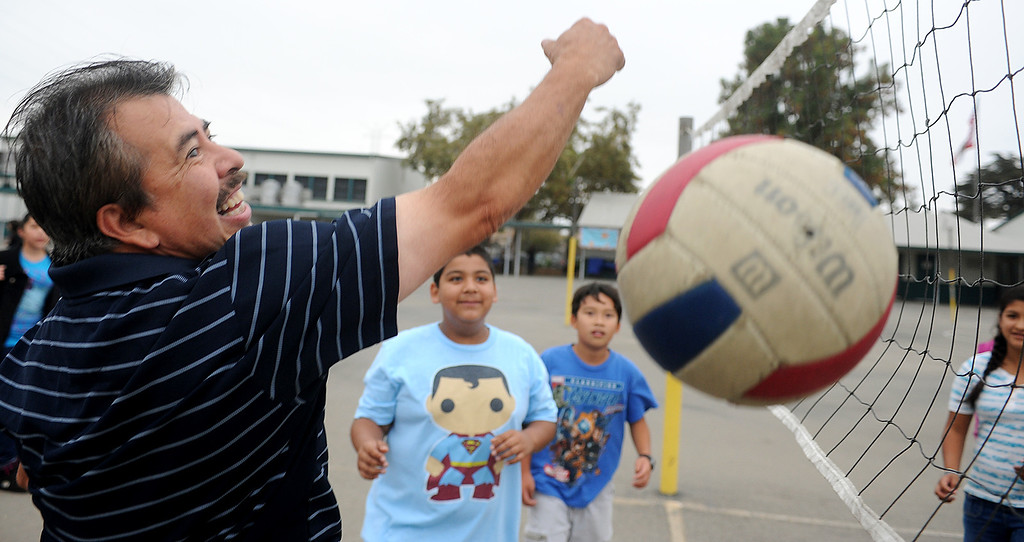 """. Parents played volleyball with their children during recess break at Elwin Elementary School in Baldwin Park, which  hosted, \""""Bring Your Dad to School\"""" Day Wednesday, October 2, 2013.(Walt Mancini/San Gabriel Valley Tribune)"""