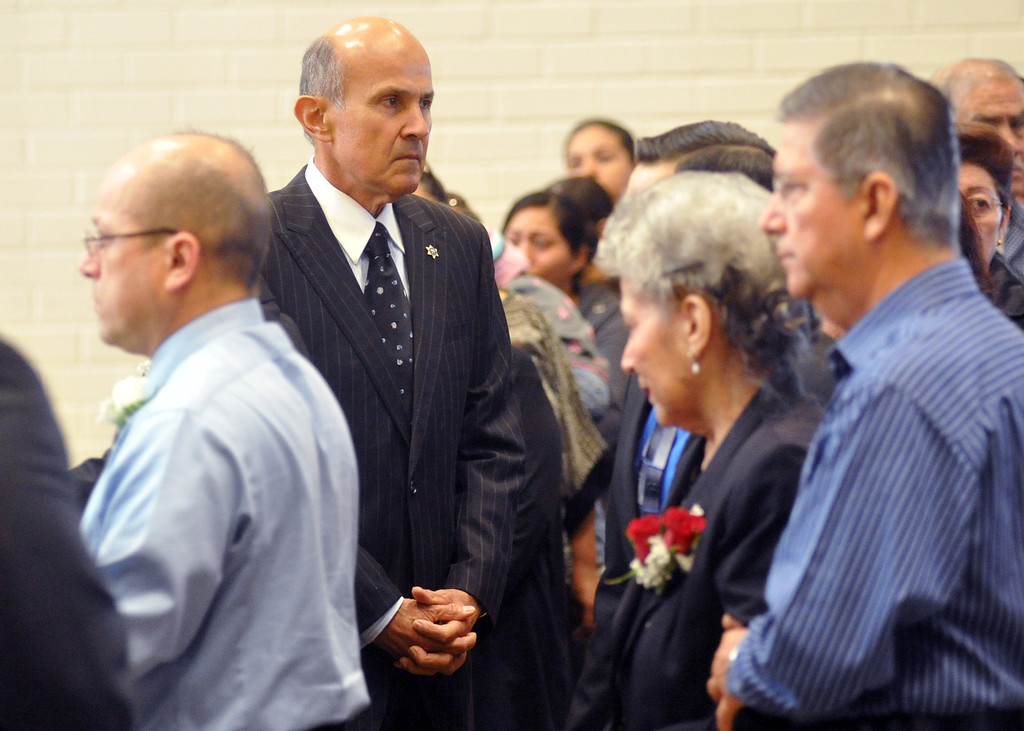 . Sheriff Lee Baca attends the funeral service for Mario Jimenez, owner of Mario\'s Taco\'s, at St. Hillary\'s Catholic Church in Pico Rivera on Tuesday October 15, 2013. Jimenez who had been an active member of the community and hosted their free Thanksgiving dinners, died Wednesday October 8th after a long battle with cancer. (Whittier Daily News/Staff Photo by Keith Durflinger)